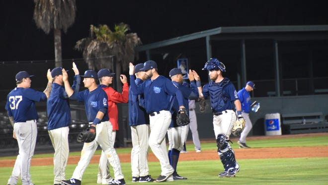 The Mobile BayBears celebrate their season-opening, 9-3 win Thursday night against the Blue Wahoos.