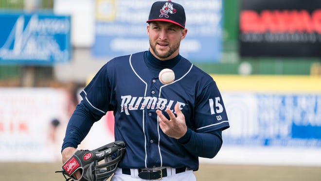 Apr 7, 2018; Binghamton, NY, USA; Binghamton Rumble Ponies left fielder Tim Tebow (15) warms up prior to the game against the Portland Sea Dogs at NYSEG Stadium.