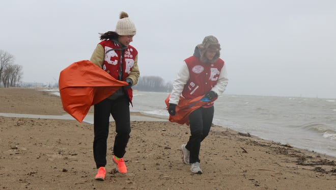 Despite heavy rain and wind, local Port Clinton High School students Erin Hiller and Nikolas Skoufos volunteered their Saturday morning to help clean up the city beach.