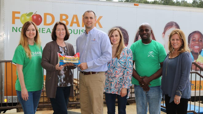 Tripp Shepherd with Rabo AgriFinance and executives of KenChaux Rice presented the Northeast Louisiana Food Bank with 4,320 pounds of high-quality, locally grown rice for families in the 12-parish region. Pictured, left to right: Sarah Hoffman and Jean Toth with the Northeast Louisiana Food Bank; Shepherd; Meryl Kennedy Farr with KenChaux Rice; Lawrence Jenkins with the Food Bank; and Patchez Kennedy Fox with KenChaux Rice.