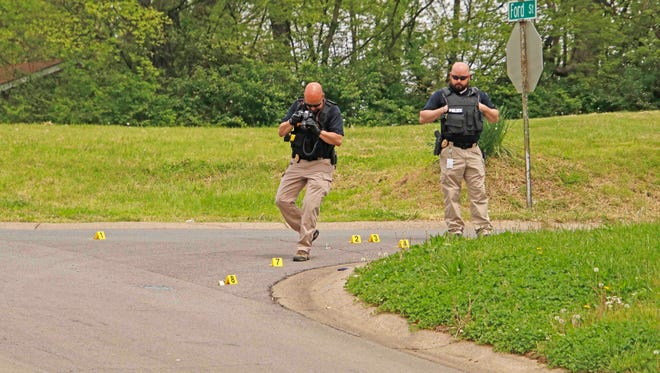 Police investigate the scene of a shooting on Ford Street Wednesday afternoon.