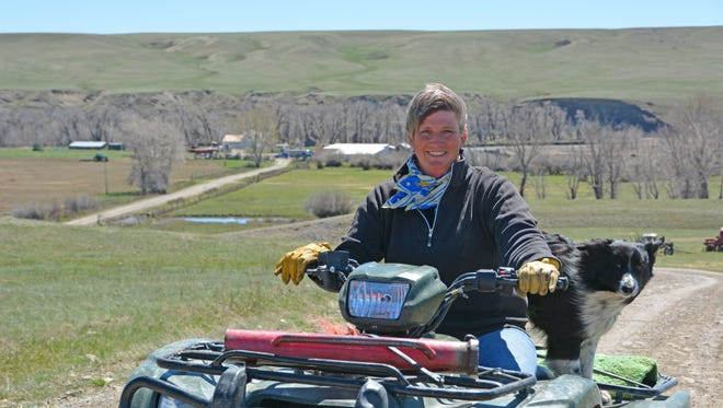 Colleen Gustafson from Cut Bank rides an ATV. She said the land calls to her.
