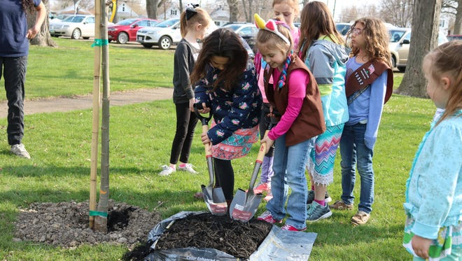 Local Cub Scout Pack 361 and Girl Scout Troop 10352 made special history and tree-related presentations and helped spread mulch on freshly planted new trees on Arbor Day this year.