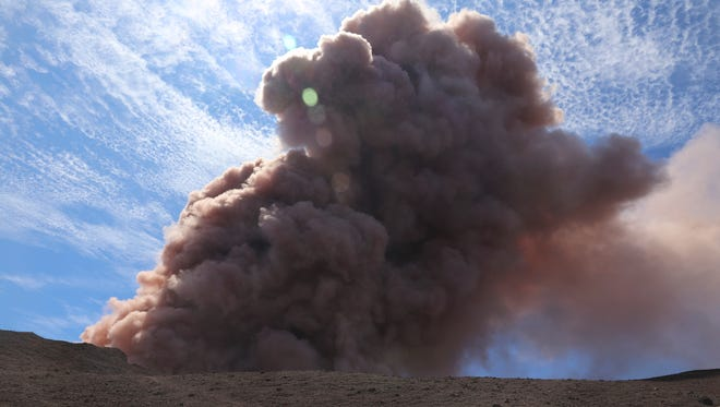 In this photo released by U.S. Geological Survey, a plume of ash rises from the Puu Oo vent on Hawaii's Kilauea Volcano after a magnitude 5.0 earthquake, on May 3, 2018, in Hawaii Volcanoes National Park.