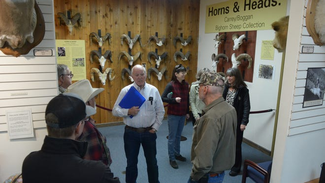 Members of the Jack O'Connor Hunting Heritage and Education Center, Idaho Fish and Game employees and others gather in front of the Carrey/Boggan Collection of bighorn sheep skulls prior to presentation on a genetic study of the horns.