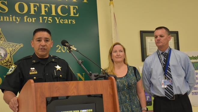 Santa Rosa County Sheriff's Office spokesman Sgt. Rich Aloy explains the agency's new SpeakOut app to report suspicious behavior. With him is Santa Rosa Crime Stoppers president Shari Thieman-Greene and Santa Rosa County School District director of high schools Jason Weeks.