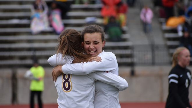 Windsor players Chaynee Kingsbury, facing, and Sarah Johnson hug after the Wizards beat Silver Creek 2-1 in the Class 4A state soccer semifinals at Legacy Stadium in Aurora on Saturday.