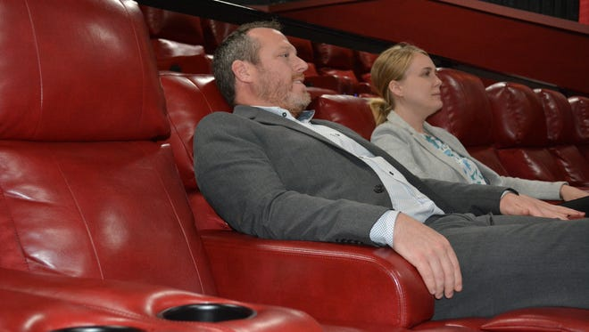 Majestic operations manager Shawn Mellon and Marcus communications specialist Julie Caan relax in one version of Marcus Theatre's new DreamLounger recliners inside one of the smaller screening rooms inside The Majestic Cinema in the town of Brookfield. The electrically controlled recliners are now featured in all screens, ultra large and large.