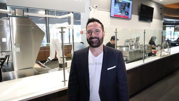 David Zito, CEO of Miso Robotics, with Flippy the robot