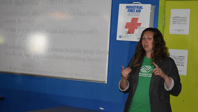 Dianna Sullivan, director of Family Support for the Boys & Girls Clubs of South Puget Sound, leads a presentation on suicide prevention at the North Mason Boys & Girls Club Teen Center, Tuesday, May 29. The program was made possible through a donation from UnitedHealthcare to support mental health programs.
