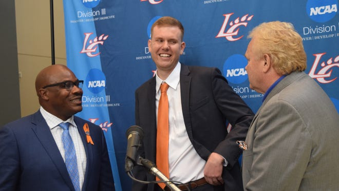 Reni Mason (lett) athletic director at Louisiana College, and Rick Brewer (right), LC president, announced Matt Lebato (center) as the news women's head basketball coach Thursday. The 27-year-old is from Sulphur and a graduate of Northwestern State University.
