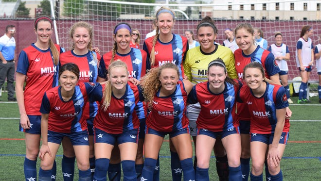 Lansing United's women's team poses before taking the field for its game at Grand Rapids earlier this season.