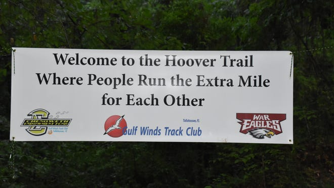 Banner at the Potluck Dash honoring the late Wakulla High Coach Paul Hoover who was killed by a hit and run driver while running in 2017.
