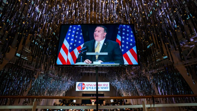 Secretary of State Mike Pompeo is seen in a television monitor as speaks to the media in Singapore on June 11, 2018.