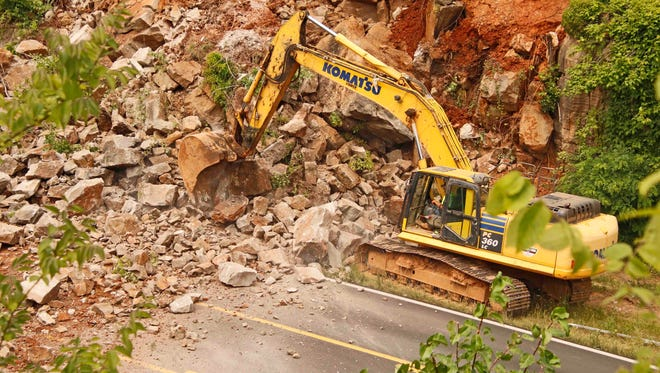 Warfield Boulevard near Dunbar Cave Road was covered in demolition debris for part of the day Tuesday.