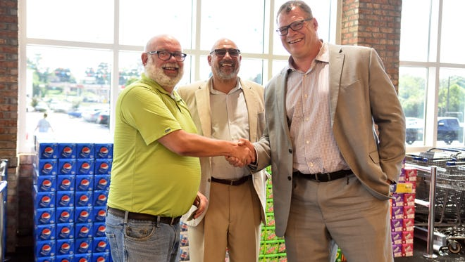 Gary Jones, Joe Armstrong and Glenn Jacobs gathered for the ribbon cutting ceremony at the remodeled Halls Food City location on Tuesday, June 12, 2018.