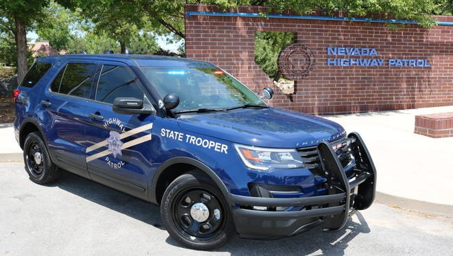 A side view of a Nevada Highway Patrol vehicle outfitted in normal markings.