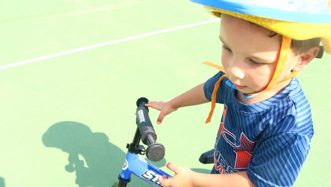 2 year-old Andre Stephens practices riding his balance bike in preparation for the Strider Cup World Championship race at Lee Martinez Park in Fort Collins on Monday, July 2, 2018.