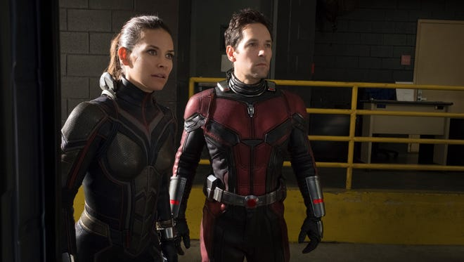 """This image released by Marvel Studios shows Evangeline Lilly, left, and Paul Rudd in a scene from """"Ant-Man and the Wasp."""" (Disney/Marvel Studios via AP)"""