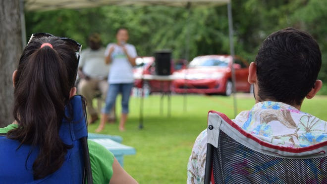 Lualhati Johnson (left) and Nathanael Viola listen to City Commission candidate Lisa Brown Saturday morning at the Frenchtown Farmers Market.