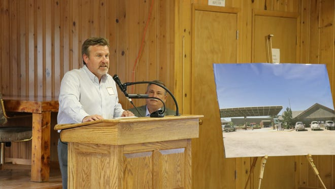 Ed Lott, regional sales manager for EBSCO Information Services, speaks at a grant ceremony for a solar array at Red Feather Lakes Library on Tuesday, July 10.