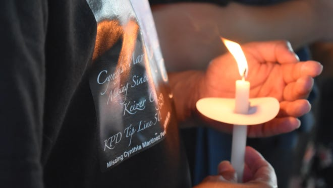 Family and community members gathered at Chalmer Jones Park Monday evening in remembrance of Woodburn mother of four who went missing on July 16, 2017.