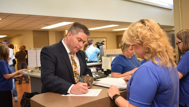 Jamie Floyd (left) qualifies with Robin Hooter (right), Rapides Parish clerk of court, to run for the Rapides Parish School Board seat in District C at the Rapides Parish Clerk of Court's office Wednesday, July 10, 2018. Floyd is one of four candidates running for the District C seat.