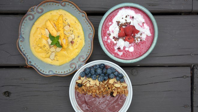 Three smoothie bowls: mango and turmeric lassi, beet-banana-apple and acai. The breakfast innovation emphasizes healthy ingredients.
