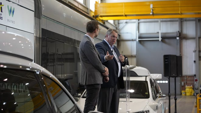 Shaun Stewart (left), Waymo chief business development officer, is introduced by Scott Smith, Valley Metro CEO, as Valley Metro announces its first-of-its-kind partnership with Waymo.