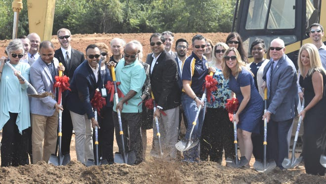 Officials break ground on Wednesday, Aug. 22 at the Highway 49 East site where a new Hampton Inn is coming to Pleasant View. The hotel is expected to open in 2019.