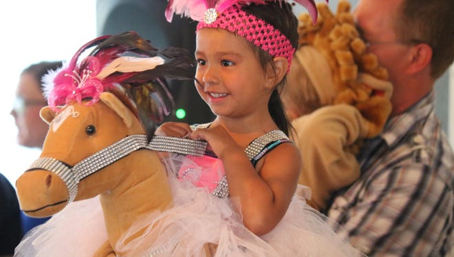 Isabella Wadsworth, 3, of Fremont, helped pick out her own first place custom, showing a glamorous side of horseback riding, at the Sandusky County Fair's annual baby contest on Saturday.