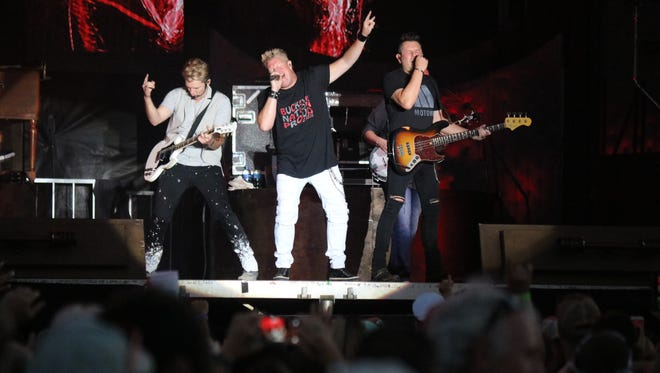 """Joe Don Rooney, left, Gary LeVox, center, and Jay DeMarcus of Rascal Flatts rocked the """"Bash on the Bay"""" on Thursday night at the Put-in-Bay Airport."""