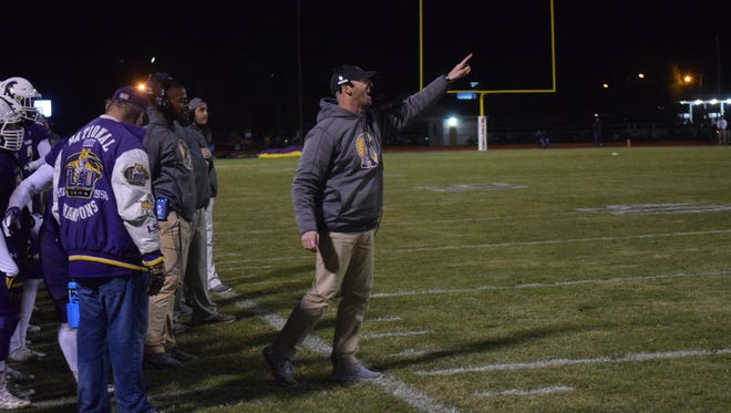 Alexandria Senior High coach Thomas Bachman (center) instructs his players as defeated Central High School of Baton Rouge 45-24 Friday, Nov. 9, 2018 to win their first playoff game since 2011 and as a member of 5A.