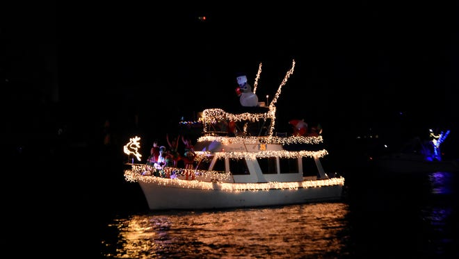 """FAN FAVORITE - The Fan Favorite winner at the Palm Beach Holiday Boat Parade on Dec.1 was The Goode Life, a 34-footMarine Trader trawler owned by Allan and Cheryl Goode of Stuart. """"We had planned to have Santa and his elves on board, but we were told there could only be one Santa, so mean old Grinch landed on the boat and the elves turned him into a nice Grinch,"""" Allan Goode said. """"This was our first Palm Beach Boat Parade - and we loved it.The Marine Industries Association of Palm Beach puts on a a fantastic show, and we'll be back again."""""""