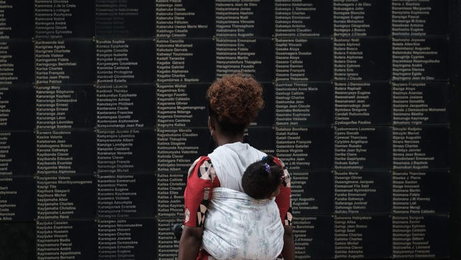A wall lists victims' names at the Kigali Genocide Memorial in Rwanda.
