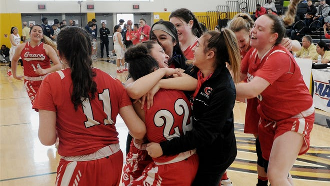 Grace Brethren players celebrate after defeating St. Pius X-St. Matthias Academy 59-33 in the CIF-Southern Section Division 5AA championship game Saturday at Godinez High. The Lancers won the school's first CIF girls basketball title.