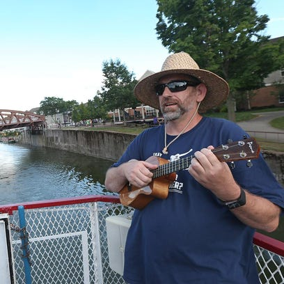 Michael Overman of Fairport plays on his ukelele as