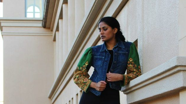 The author wearing a piece she designed. The sleeves are pieces from an old Indian salwar.