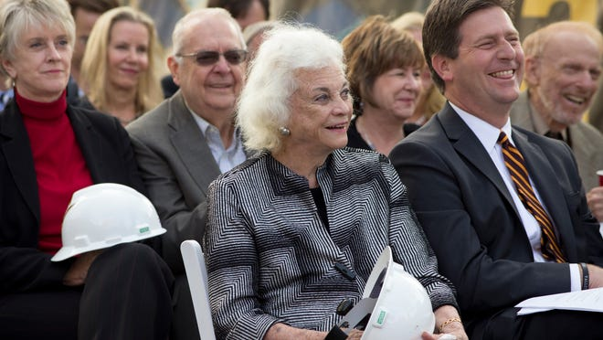 Retired U.S. Supreme Court Justice Sandra Day O'Connor (center) and Phoenix Mayor Greg Stanton listen during the official groundbreaking ceremony for the Arizona Center for Law and Society in downtown Phoenix. The building will house the law school named after O'Connor.