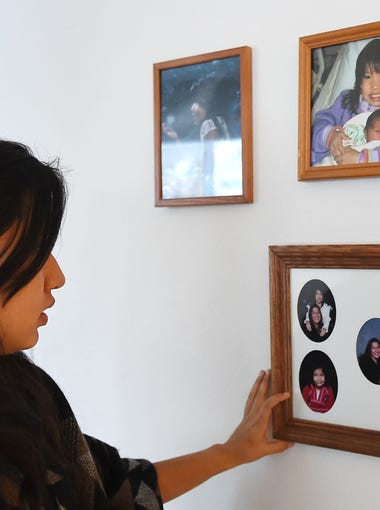 Bella Cordova, 16, points out family photos with her mom and sister, Ariana, on January 6, 2016. Ariana, 11, died by suicide in November.
