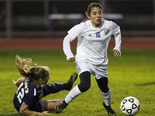 Soledad's Belinda Ascencio makes a move to slip past King's Academy's Abby Alford (12) during a girls CCS Division II playoff match.