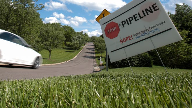 A sign protesting the proposed route of a pipeline sits in the front yard of a home in the Tangleridge subdivision of Blue Ash. The group, Neighbors Opposed to Pipeline Extension, or NOPE!, believe the pipeline should be constructed outside of populated areas, regardless of socio-economic status.