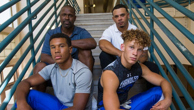 Chandler running backs DeCarlos Brooks (left) and Drake Anderson with their fathers Carlos Brooks (left) and Damien Anderson in Chandler.