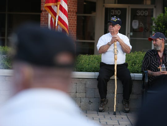 Audience members listen during the annual POW/MIA Candle