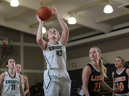 Shasta College's Rachel Eubanks goes up for a shot in the Knight's 84-33 win Wednesday night over the Lassen College Cougars.