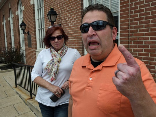Sal Perticone talks about the current state of health care while he and wife, Kim, were out for a walk around downtown Chambersburg. The Perticone's recently moved to Franklin County from New York.