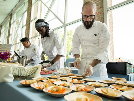 Chef Patrick Bradley of Tonic Bar and Grill prepares his dish, lobster crepe topped with lobster mascarpone and served with a ginger carrot salad and english pea emulsion, at the 20th Annual Celebrity Chefs Brunch held at the DuPont Country Club in Wilmington on Sunday afternoon.