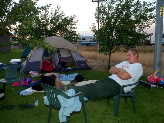 Will Bernstrauch sits at a campsite at the Clearwater