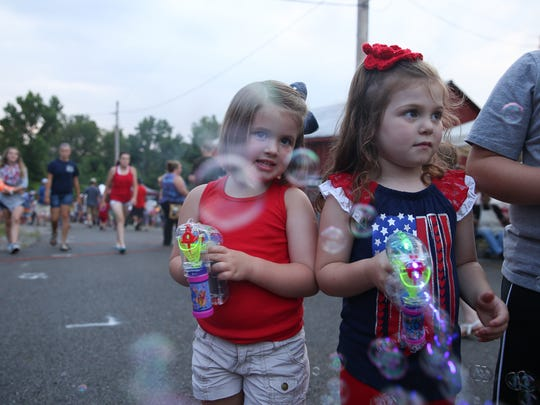 Mya Jane Welker, left, and Macy Jean enjoy making bubbles