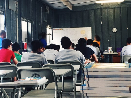 Unaccompanied immigrant children take part in educational activities in September 2016 at Fort Bliss' Doña Ana Range Complex, near Chaparral, N.M. The complex housed 500 unaccompanied immigrant children.